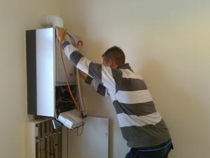 one of our Rockwall water heater repair techs fixing a unit